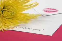 Love note. With a kiss print and a flower Royalty Free Stock Photography
