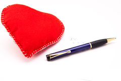 Love note. Felt heart and a pen Royalty Free Stock Photo