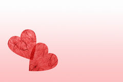 Love note. With two overlapping hearts of natural paper Stock Image