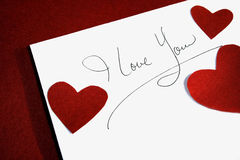 Love note. On a red background Royalty Free Stock Photography