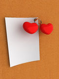 Love note on corkboard. Empty note with hearts on corkboard Royalty Free Stock Images