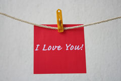 Love note hanging on the string. With yellow clip royalty free stock images