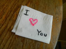 Love Note. Romantic love note heart message left on a table Royalty Free Stock Images