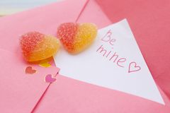 A love note in a pink envelope stock photos