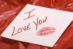 Love note on red gift wrap Stock Images