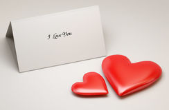 Love note and two red hearts. With place for your text Royalty Free Stock Photo