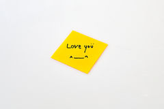 Love note. On the yellow post-it Royalty Free Stock Photo