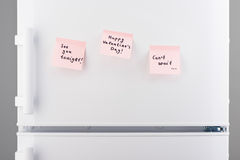 Love notes on pink sticky paper on white refrigerator door Royalty Free Stock Photography