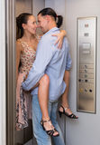 Love at office lift. Hot beautiful women with her colleague making love at office lift Royalty Free Stock Images