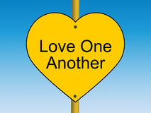 Love one Another road sign Stock Image