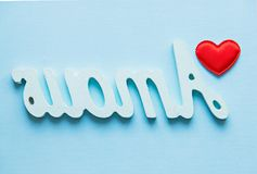 Love the opposite. red heart and the word amour on a blue background.  Stock Photos