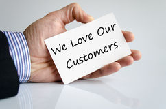 We love our customers. Business hand writing text We love our customers Stock Photo