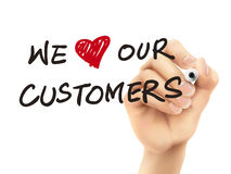 We love our customers words written by 3d hand. Over white background Royalty Free Stock Photos