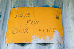 Love For Our Home sign is displayed at Pepo La Tumaini Jangwani, HIV/AIDS Community Rehabilitation Program, Orphanage & Clinic.  P Royalty Free Stock Image