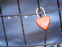 heart padlock on icy fence Stock Image