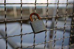 Love padlock chained to bridge Royalty Free Stock Images