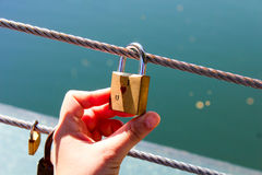 Love padlock hanging on a wire Royalty Free Stock Photos