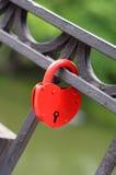 Love Padlock. Red heart shaped padlock hanging on a bridge Royalty Free Stock Photos