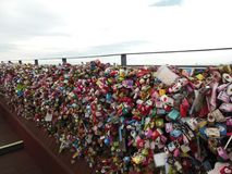 Love padlocks as engagement symbol on bridge stock photo