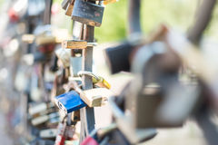 Love padlocks attached to the bridge. Europe. Stock Photography