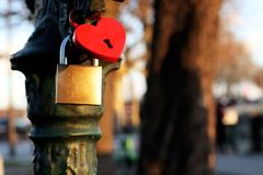 Love padlocks background card with heart shape in Paris, France. Paris the city of love and romance : valentines day Red love padlocks with heart shape stock photo