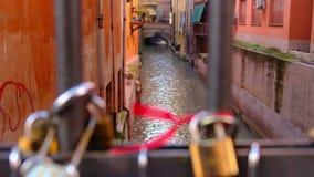 Love padlocks in Bologna canal bridge - Italy