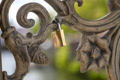 Love padlocks on the bridge. Fence above the river Stock Photos