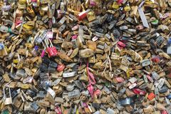 Love padlocks at bridge over river Seine in Paris, France Stock Photography
