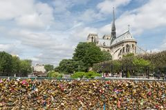 Love padlocks at bridge over river Seine in Paris, France Royalty Free Stock Image