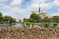 Love padlocks at bridge over river Seine in Paris, France Stock Photography