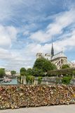 Love padlocks at bridge over river Seine in Paris, France Royalty Free Stock Photography