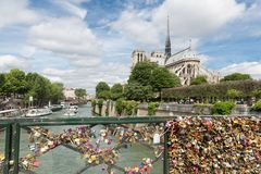 Love padlocks at bridge over river Seine in Paris, France Stock Photos
