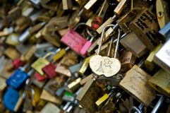 Love padlocks in a bridge over the Seine river in Paris Stock Photos