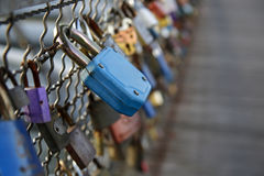 Love padlocks chained to bridge Stock Photos