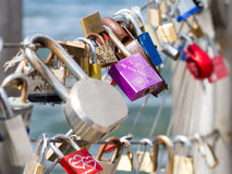 Love padlocks chained to the Brooklyn Bridge in New York. City stock photo