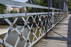 Love padlocks on Elizabeta Bridge railing on Somes River on August 21, 2018 in Cluj-Napoca. CLUJ-NAPOCA, TRANSYLVANIA, ROMANIA - AUGUST 21, 2018: Love padlocks royalty free stock photography