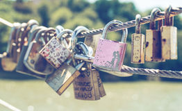 A love padlocks. A group of padlocks on the wire Royalty Free Stock Images