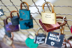 Love padlocks hanging on bridge Stock Images