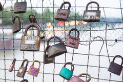 Love padlocks hanging on bridge Royalty Free Stock Image