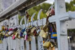 Love padlocks hanging on a bridge in Paris France Royalty Free Stock Photos