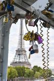 Love padlocks hanging on a bridge in Paris France Stock Photography