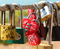Love padlocks hanging on fence. Many of love padlocks hanging on fence in Thailand Stock Photo