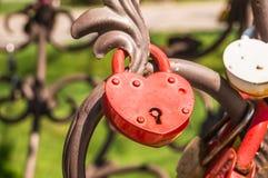 Love padlocks or love locks on a railing Stock Photo