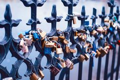 Love padlocks. All over the metal fence of Charles Bridge in Prague, Czech Republic Royalty Free Stock Photography