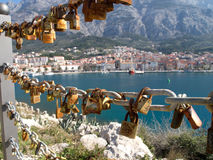 Love padlocks with mediterranean city in background Royalty Free Stock Photo