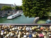 Love padlocks in Paris bridge,. France. Boat on a river Royalty Free Stock Photography