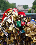 Love padlocks on Paris bridge. Love locks locked to the Pont de l'Archevêché bridge across the Seine river in Paris.  Lovers throw away the key to their lock Stock Photo