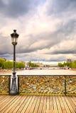 Love padlocks on Pont des Arts bridge, Seine river in Paris, France. stock photos