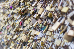 Love padlocks on Pont des Arts bridge, Seine river in Paris. Fra Stock Images