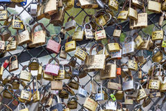 Love padlocks on Pont des Arts bridge, Seine river in Paris. Fra Stock Image